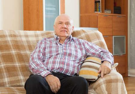 grizzled: portrait of quiet grizzled senior man in interior