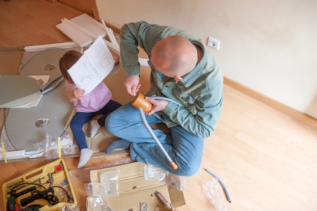 Dad and daughter renovating coffee table photo