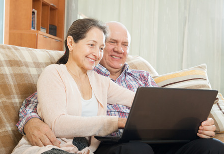 happy couple shopping at home via  Internet photo