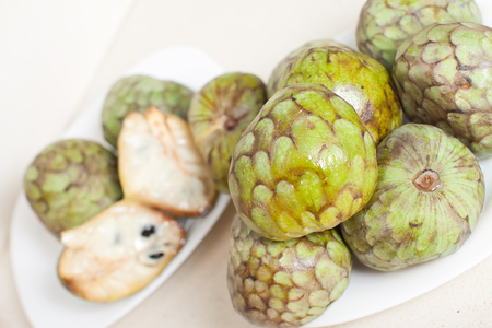 many fruits of cherimoya on table