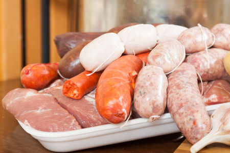 prepack:  types of traditional Spanish sausage on a cutting board
