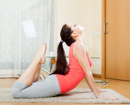 beautiful girl doing exercises of  yoga  at home Stock Photo