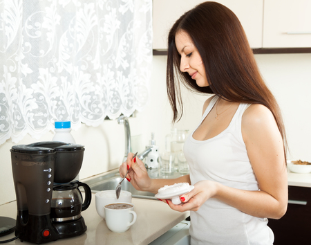 girl preparing sweet coffee in the kitchen