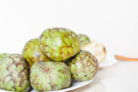 chirimoya: many fruits of cherimoya on table