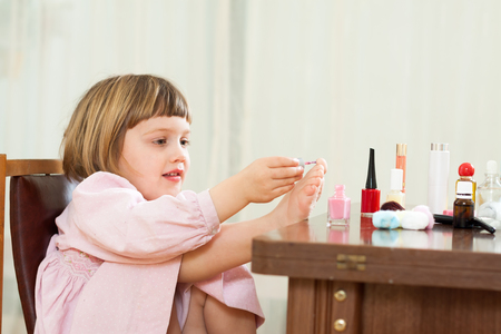 Beautiful three year old girl making pedicure Stock Photo