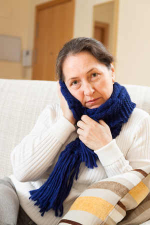unwholesome: illness woman in warm scarf