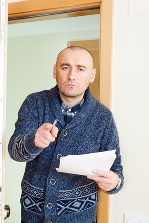 condemnation: collector  trying to get the arrears at home door Stock Photo
