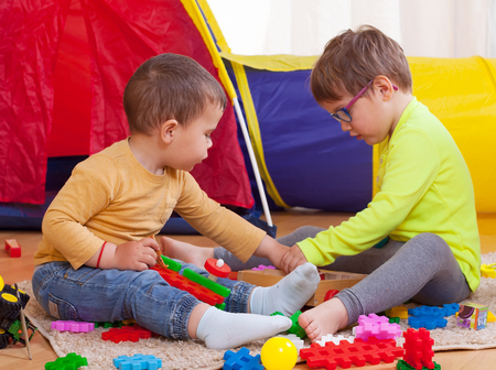 Young children playing together at home.  photo