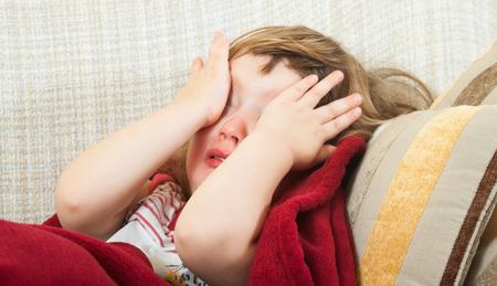 Diseased girl  under  blanket at home photo
