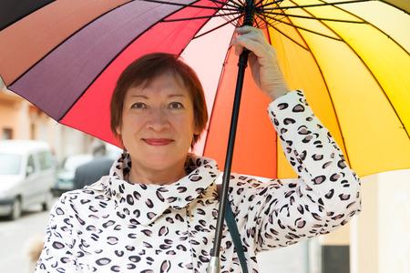 happy seasonable: Portrait of   mature woman with umbrella in autumn Stock Photo