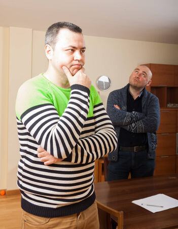 sort out: Portrait of two sad men at home Stock Photo