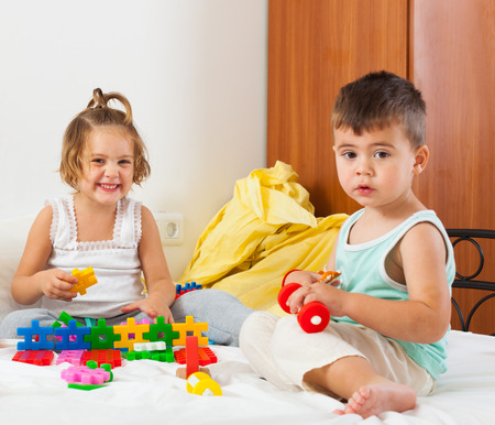 children playing on  bed in  bedroom. photo