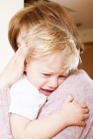 sob: Mom holding  crying child in your arms