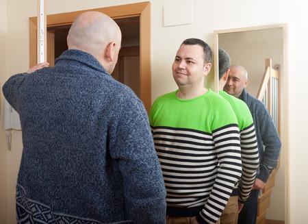 neighbor: Adult man opening  door his neighbor