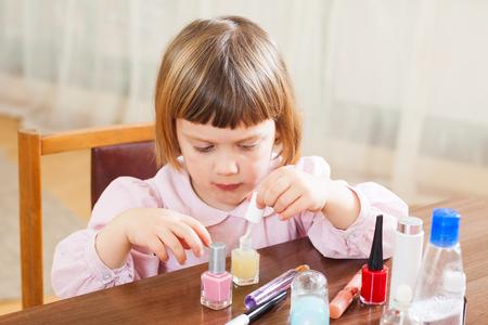 three year old: Beautiful three year old girl making manicure