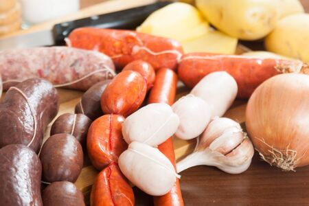 prepack: several types of traditional Spanish sausage on a cutting board