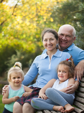 grandaughter: Portrait of grandma and  grandpa with littles grandaughters outdoor Stock Photo