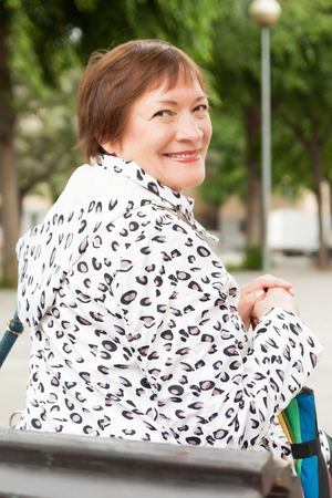pensionary: Outdoor portrait of  happy mature woman with umbrella