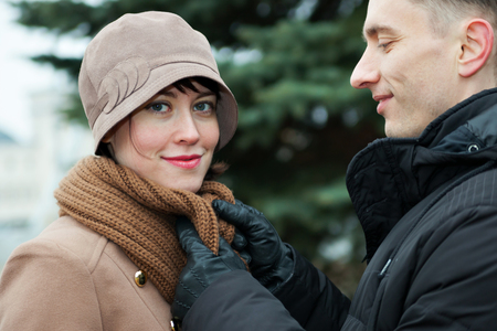 warmly: Warmly dressed man and woman walking in   park
