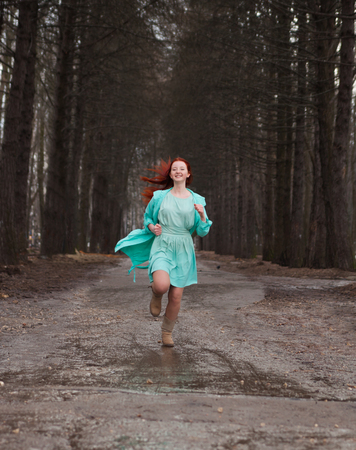 redhaired: Cute red-haired girl in   park in spring day.