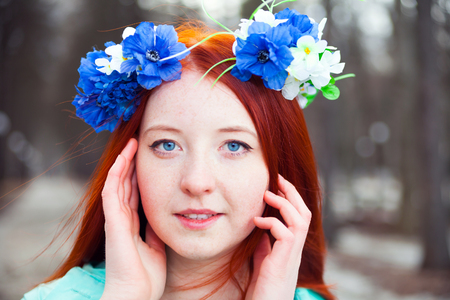 redhaired: Beautiful young red-haired girl  in   wreath of blue flowers