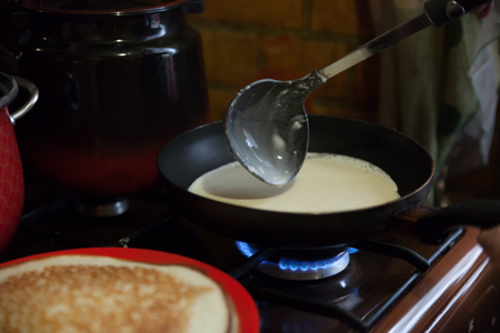 shrove tuesday: Preparation of traditional Russian  pancakes on Shrove Tuesday.