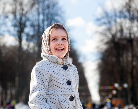 Smiling child in russian traditional clothes   during  Shrovetide Stock Photo