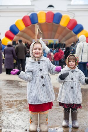 sudarium: Two little girls dansing during Shrovetide at Russia