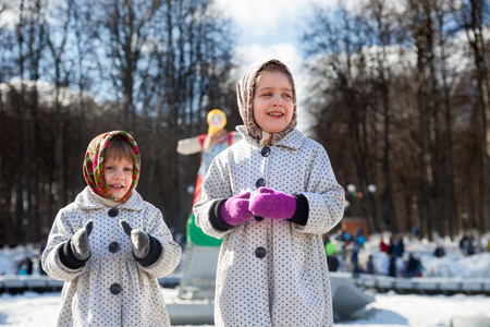 sudarium: Girls  in traditional  clothes   Maslenitsa festival Stock Photo