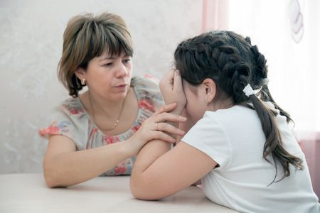 Mom calming   crying daughter   teenager