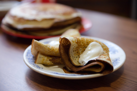 delicious pancakes with sour cream on   white plate  Stock Photo