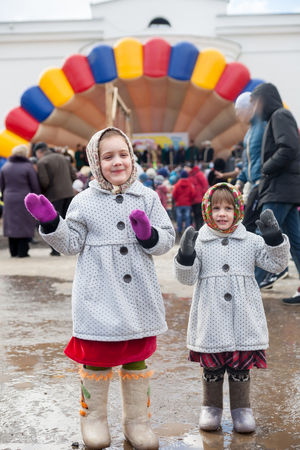 Smiling little sisters  during  Shrovetide at Russia Stock Photo