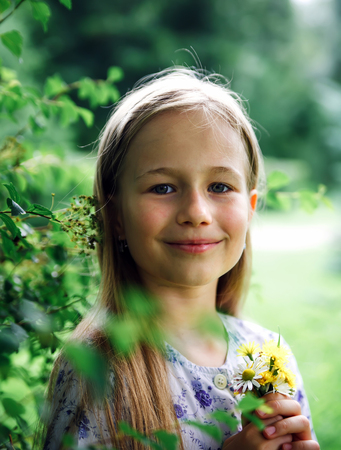 Portrait of   blond girl in   summer day Stock Photo