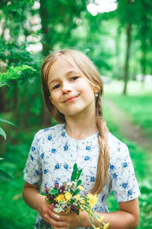 Portrait of   blond girl in   summer day Foto de archivo