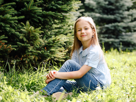 Portrait of   8 year old girl in   park