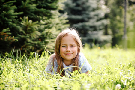 Girl of 8 years walking in   park on   grass.  Stock Photo