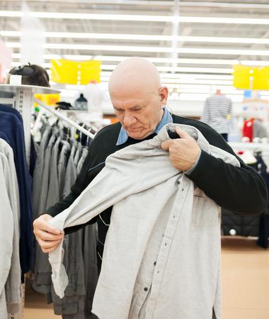 Senior man  shopping in   clothing store.