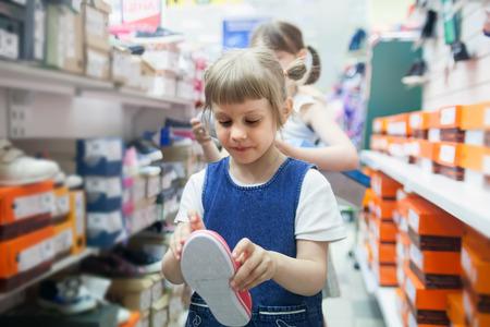 girl choosing her shoes for   kindergarten. Stock Photo