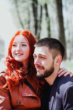 Portrait of   beautiful young couple in   spring park Stock Photo