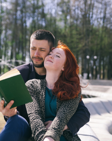 Girl with   boyfriend in   spring afternoon in  city. Stock Photo