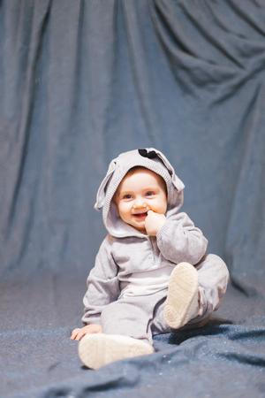 Portrait of   funny baby in   rabbit costume.