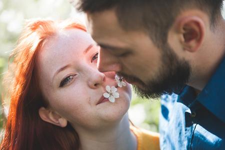 Girl with   boyfriend in   spring afternoon in garden.