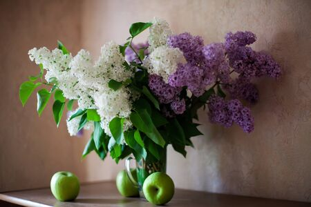 Still life with spring flowers on light background.