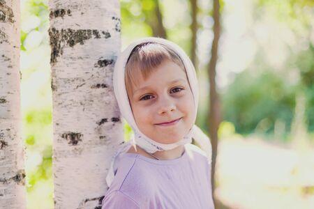 Summer portrait of seven-year-old girl in village