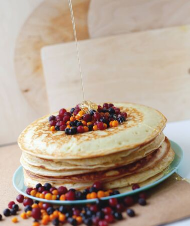 Hot delicious pancakes with different berries