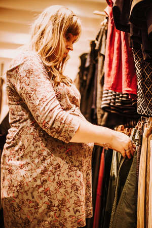 buying time: pregnant woman doing shopping early in the morning