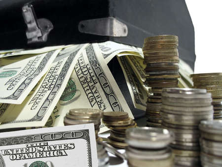 money packs: suitcase full with 100 dollar bills and a stack of coins Stock Photo