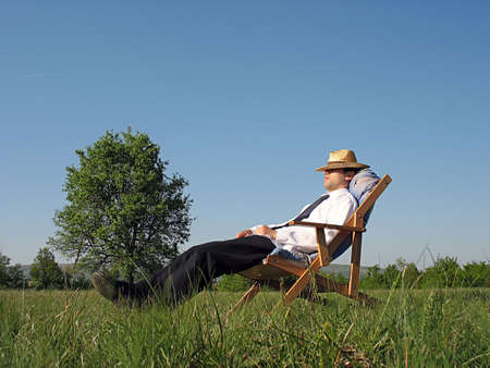 businessman relaxing in a lounge amongst nature photo