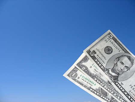 dollar bills isolated on a blue sky