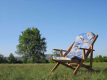 lounge chair on a relaxing green field